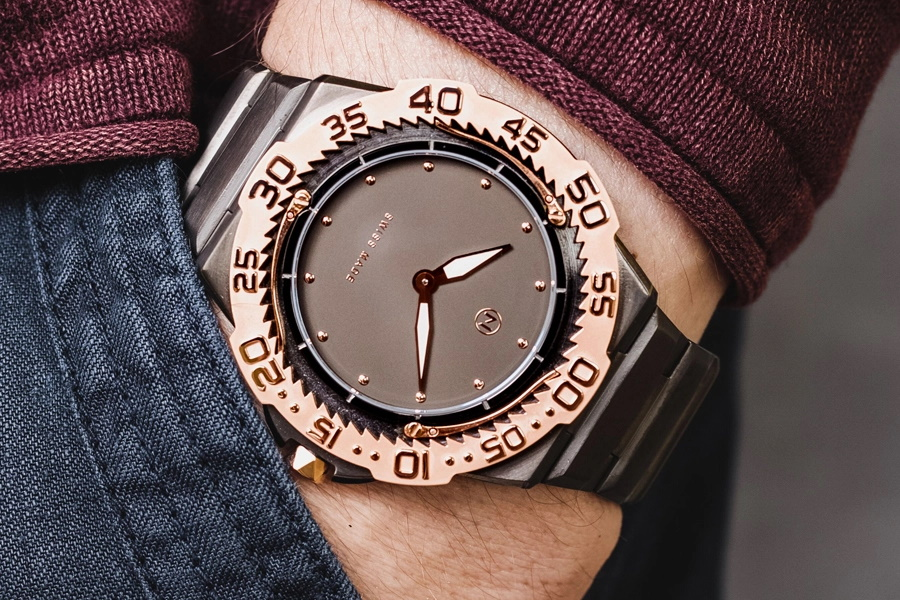 A copper bezel Nove Dive Watch on a wrist