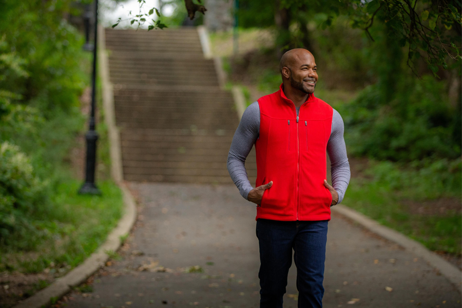 A model in a red SCOTTeVEST