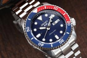 A Seiko 5 watch on a wrist