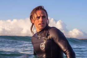 A model in sea wearing an FLRC wetsuit