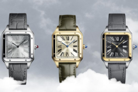 Three stainless steel. gold and stainless steel with gold Cartier Santos-Dumont watches