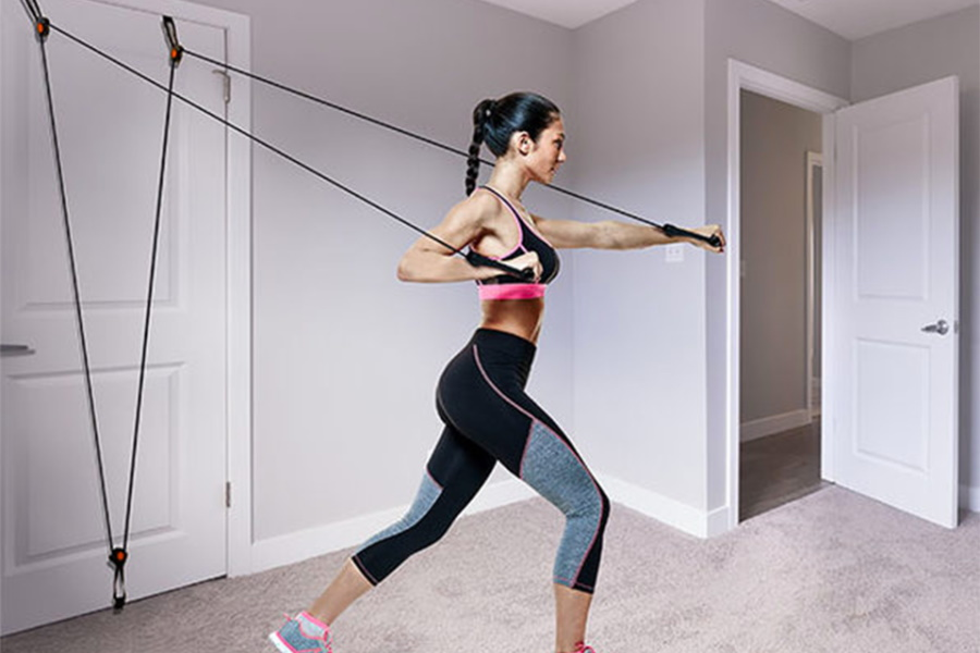 A woman training with Aduro Sport Door Gym