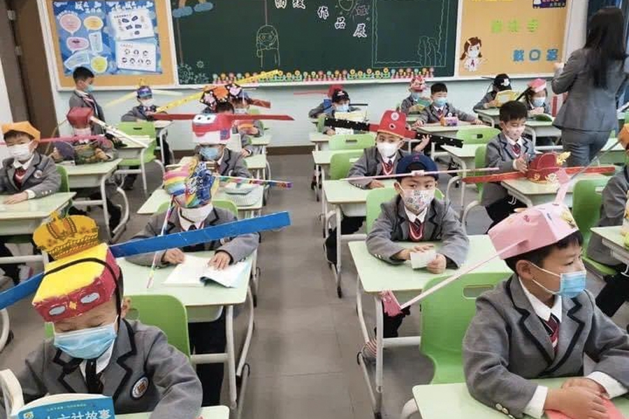 Feel-Good Friday - Chinese Kids' Social Distancing Hats