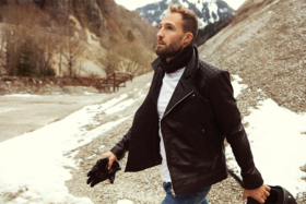 A model in a jacket from The Jacket Maker at a snowy mountain location