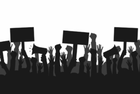 Graphic showing silhouettes of raised hands with placards