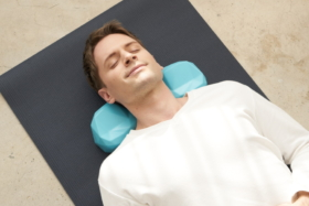 A man sleeping with neck onC-Rest Pillow