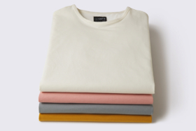 Four folded Cuts Clothing t-shirts in a stack