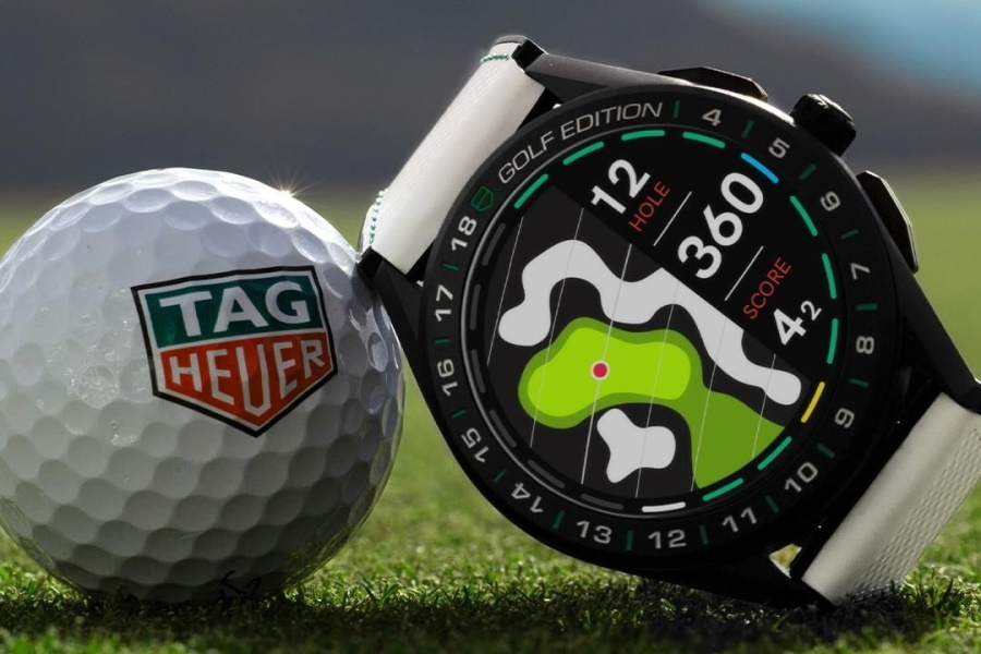 TAG Heuer Connected Golf Edition watch leaning on a golf ball on grass