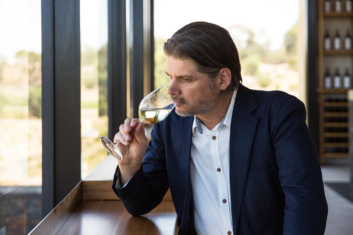 Peter Munro smelling wine