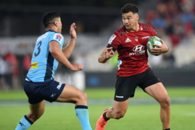 Players playing rugby at Super Rugby Trans Tasman