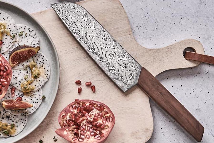 Victorinox Santoku Damast Knife on the chopping board