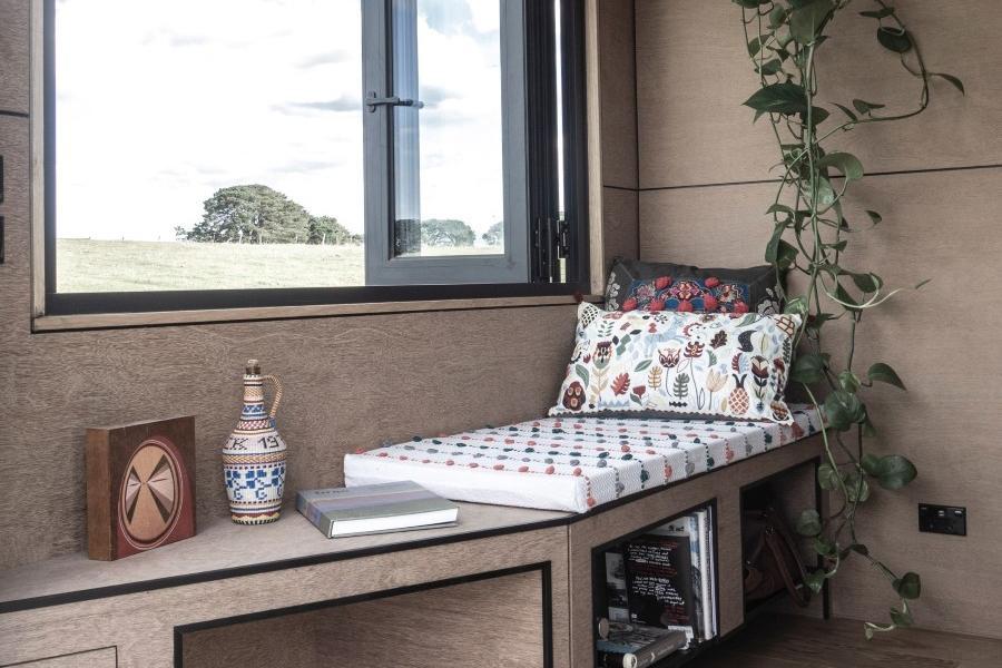 base cabin bed near the window