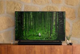 Sonos Arc Soundbar under a TV on a table
