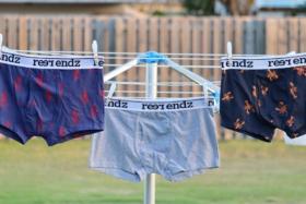 Reer Endz underwears drying on laundry strings