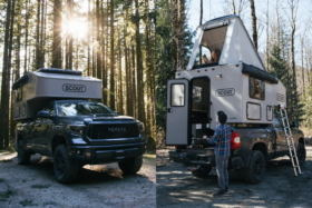 The Scout Olympic camper on a truck back and one with above-cab raised