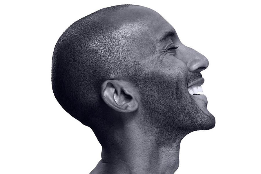 Profile of a bald man smiling