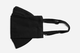 Side of a folded black Dapper Villains Face Mask