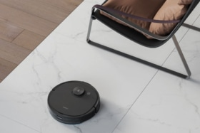 Ecovacs Deebot Ozmo T8 at feet of a chair