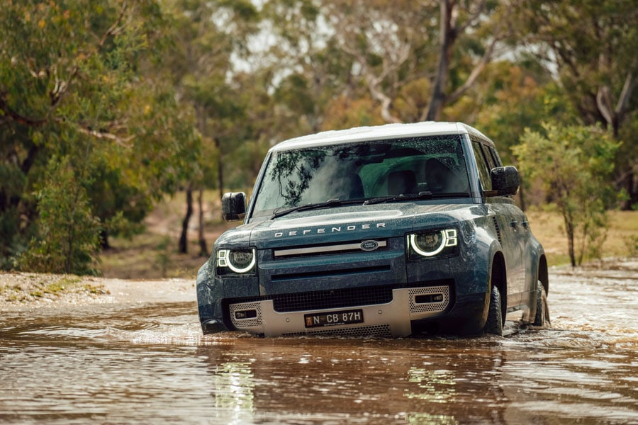 Front of Land Rover Defender crossing water