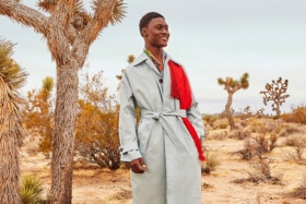 A model in a Farfetch trench coat