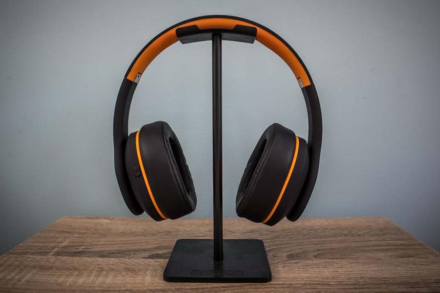 Orange Crest Headphones in stand