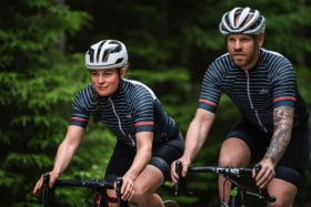 Front of two cyclists on road in Sigr apparels