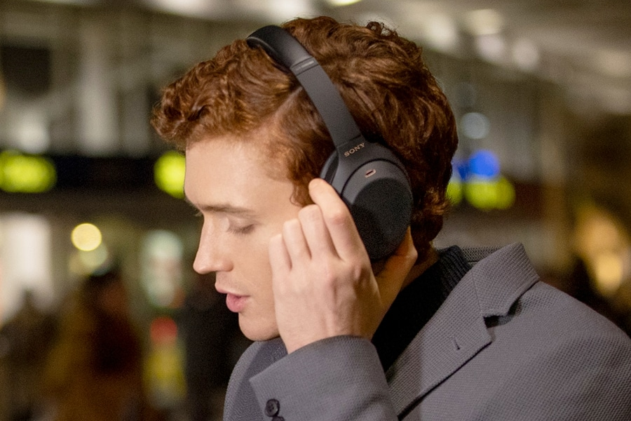 Profile of a an with Sony headphones on