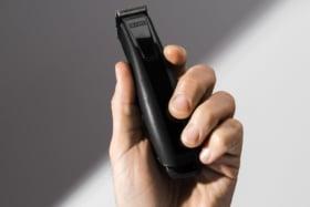 A hand holding JRLFreshFade 1040 Black Clipper