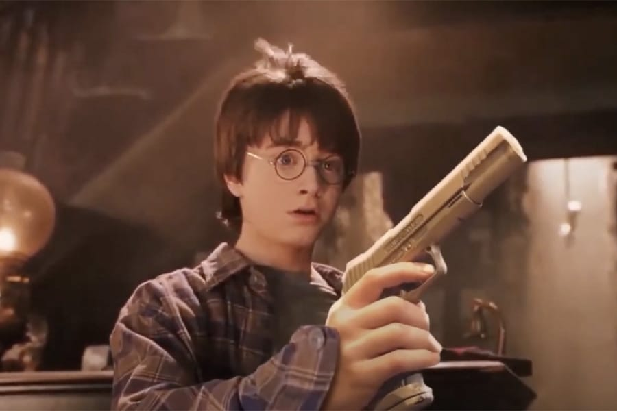 Harry Potter holding a gun