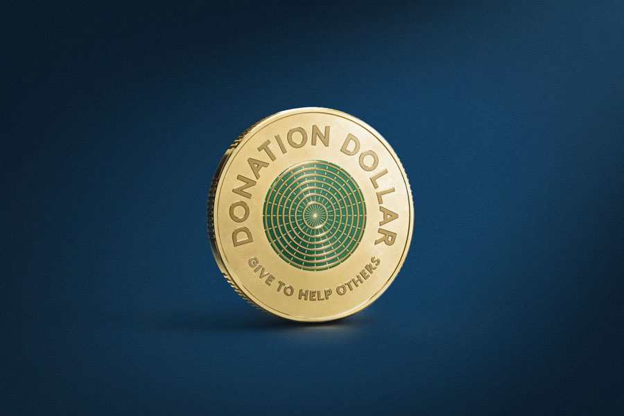 """A donation dollar with """"Give to help others"""" embossed on it"""