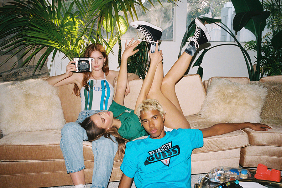 GUESS Fall 2020 Collection model in sofa