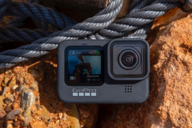 GoPro HERO9 Black on brown rocks and part of a rope in top area