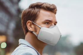man wears LG Wearable Air Purifier