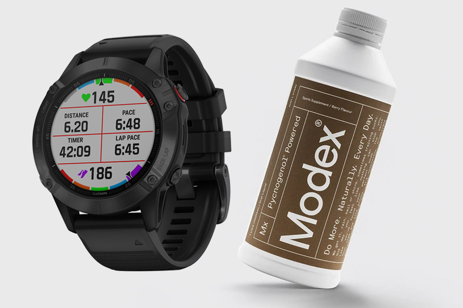 Garmin Fenix 6 smartwatch and a bottle of Modex Pycnogenol Supplement