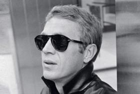 Steve McQueen wearing sunglasses