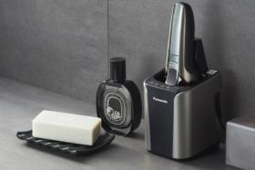 Panasonic ES-LV9Q shaver in its storage charging base on a bathroom platform