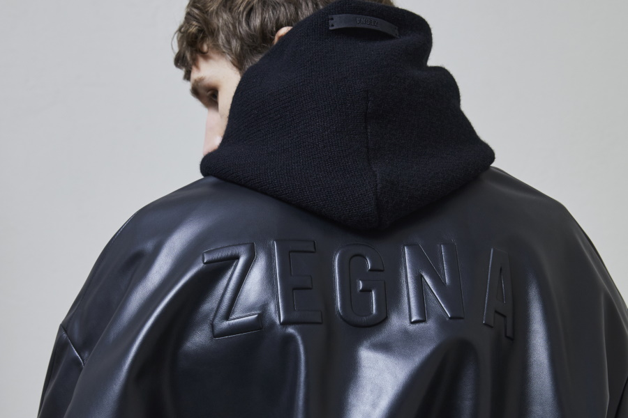 ZEGNA embossing on back of black rubber jacket fromErmenegildo Zegna x Fear of God