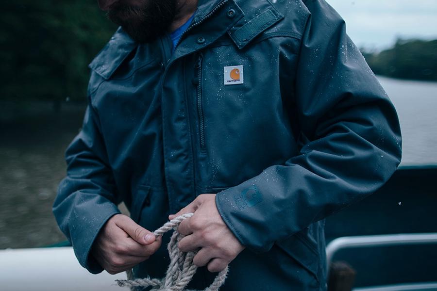 Torso of a man wearing a Carhartt jacket