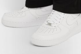 Feet wearingNike Air Force 1 '07 Leather Sneakers