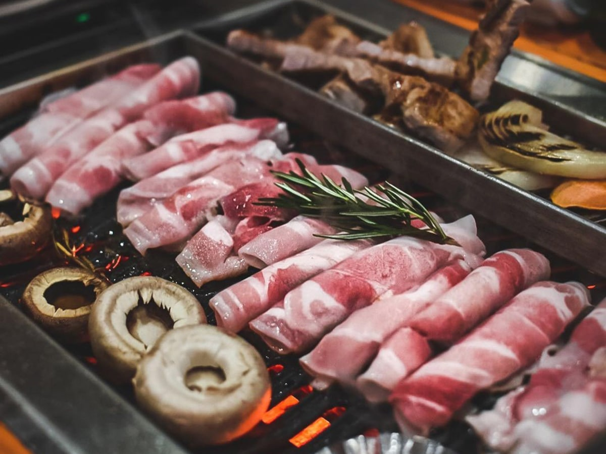 meat on grill at woodo korean barbecue