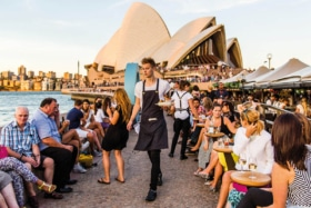 People at Opera Bar in front of Sydney Opera House