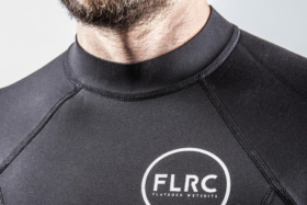A man's neck and upper chest in a Flatrock Wetsuit top