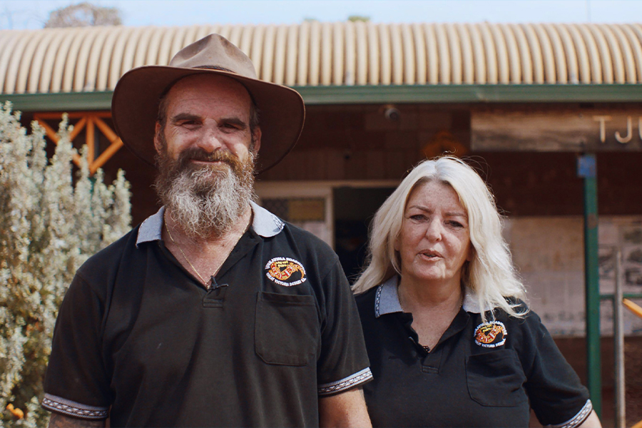 Ross and Carol in front of Tjukayirla Roadhouse