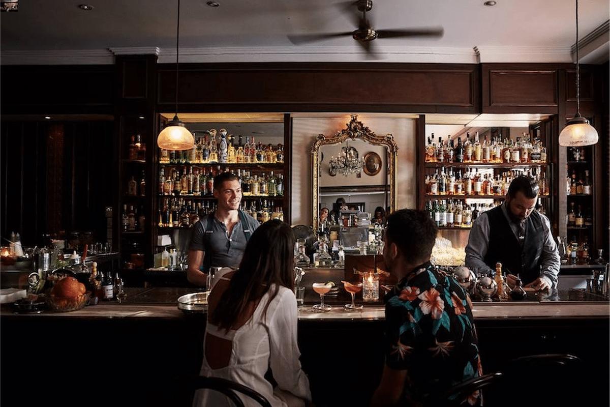 Man and a woman at a bar