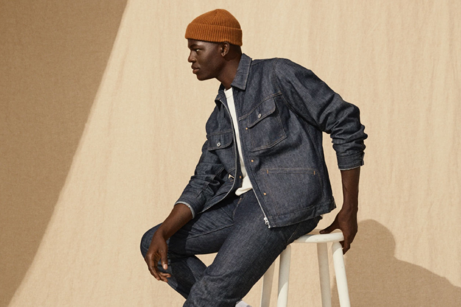 A model wearing H&M denim jacket and trousers with a white t-shirt