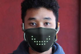 A man wearing a Jabber Mask with a wide smile made by LEDs