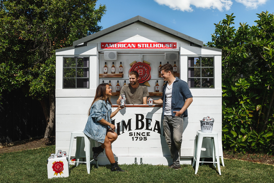Three people at Jim Beam Stillhouse with cans