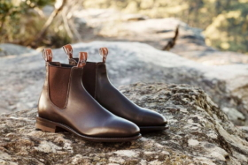 A pair of R.M. Williams boots on a rock