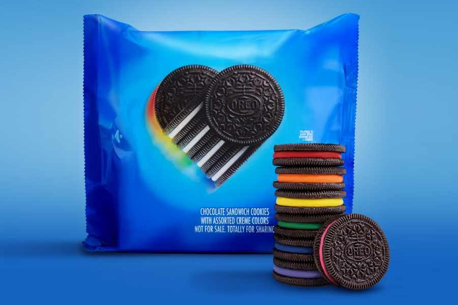 Rainbow Oreos stacked on each other in front of a pack of Rainbow Oreos