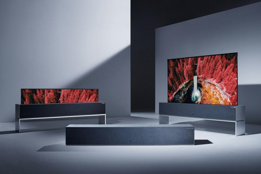 Two LG Rollable OLED TV RXs in a room with one rolled into stand